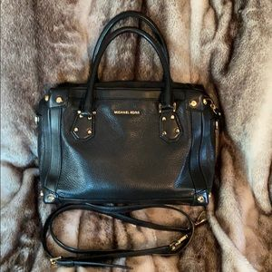Michael Kors purse with strap.